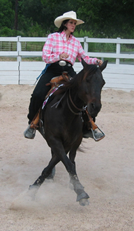 Haylie and AQHA gelding Poco Jo Peppy work on their bridleless spins